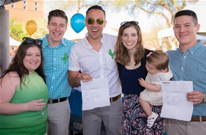 AZCOM students and their families show off their residency match information on Match Day.